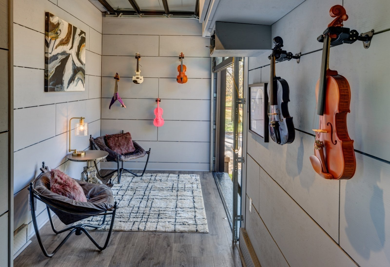 Music Room  Soundproofed with recycled denim, marine speakers on top facing the deck for the amplified sound. Tagged: Office, Craft Room, and Chair. Amplified Tiny House by Asha Mevlana
