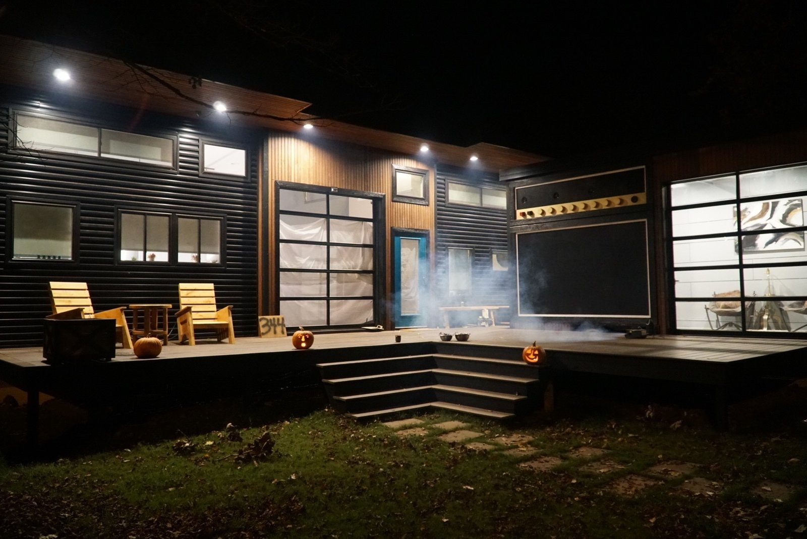 """""""Amplified"""" Tiny House at Night Tagged: Exterior, Metal Roof Material, Metal Siding Material, and Wood Siding Material.  Amplified Tiny House by Asha Mevlana"""