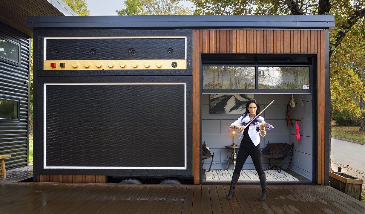 """""""Amplified"""" Studio built on wheels for transportation Any electric instrument can """"plug"""" into the amp. Sound comes out of the four marine speakers on top designed for all kinds of weather. Tagged: Exterior, Metal Roof Material, Wood Siding Material, and Metal Siding Material.  Amplified Tiny House by Asha Mevlana"""