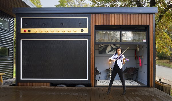 """""""Amplified"""" Studio built on wheels for transportation Any electric instrument can """"plug"""" into the amp. Sound comes out of the four marine speakers on top designed for all kinds of weather. Photo 14 of Amplified Tiny House modern home"""