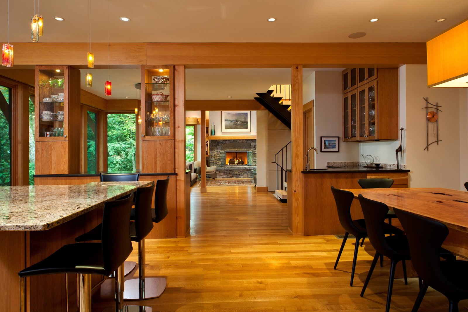 Open floorplan of house - kitchen, dining area, living room  Fourth Lake Summer House by Phinney Design Group
