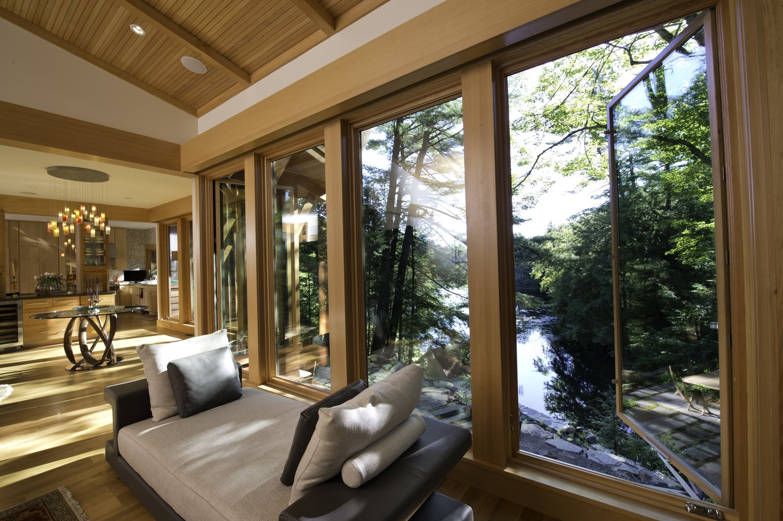 Living room overlooking Lake Luzerne  Fourth Lake Summer House by Phinney Design Group