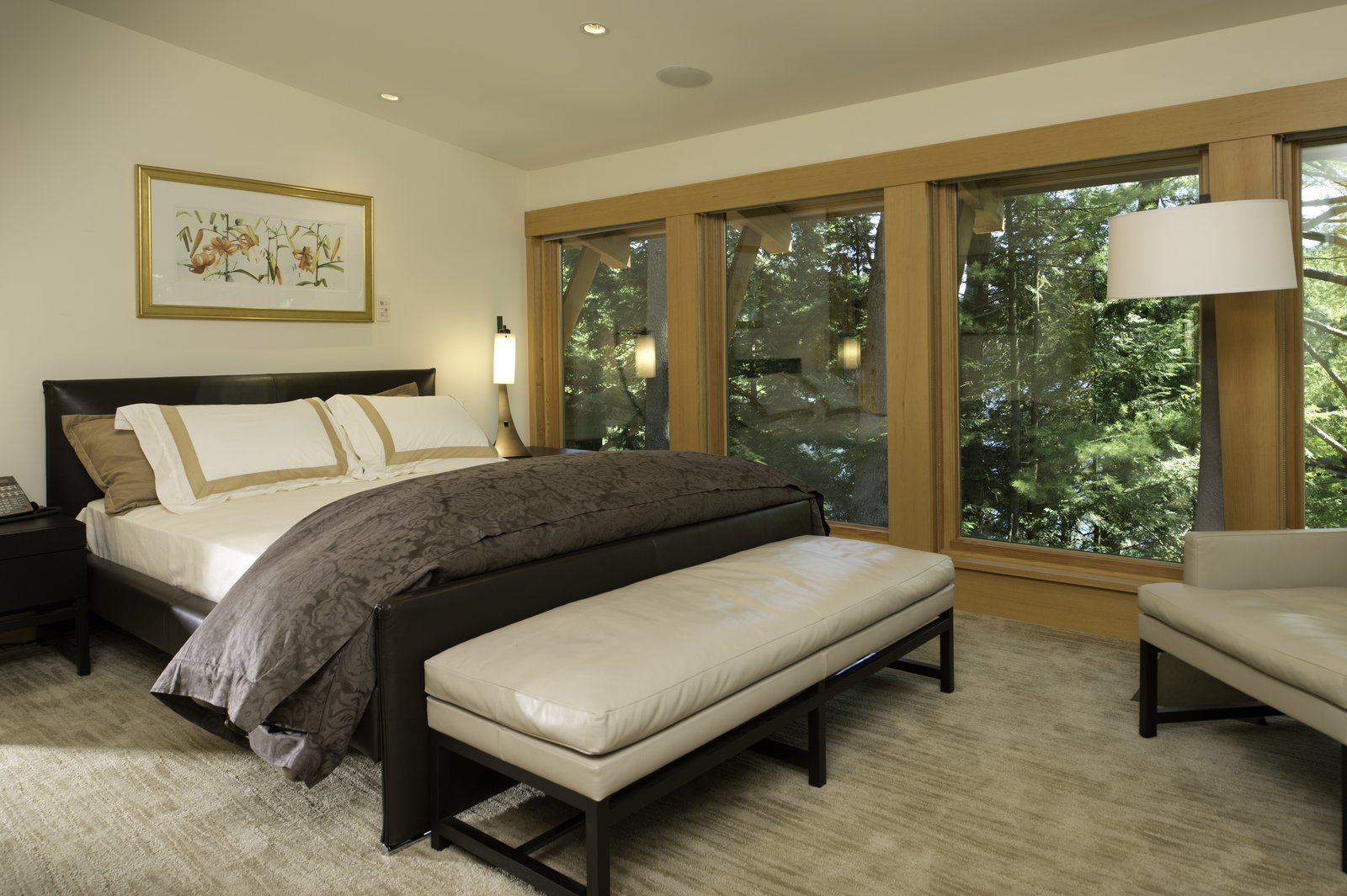 Master bedroom, overlooking Lake Luzerne   Fourth Lake Summer House by Phinney Design Group