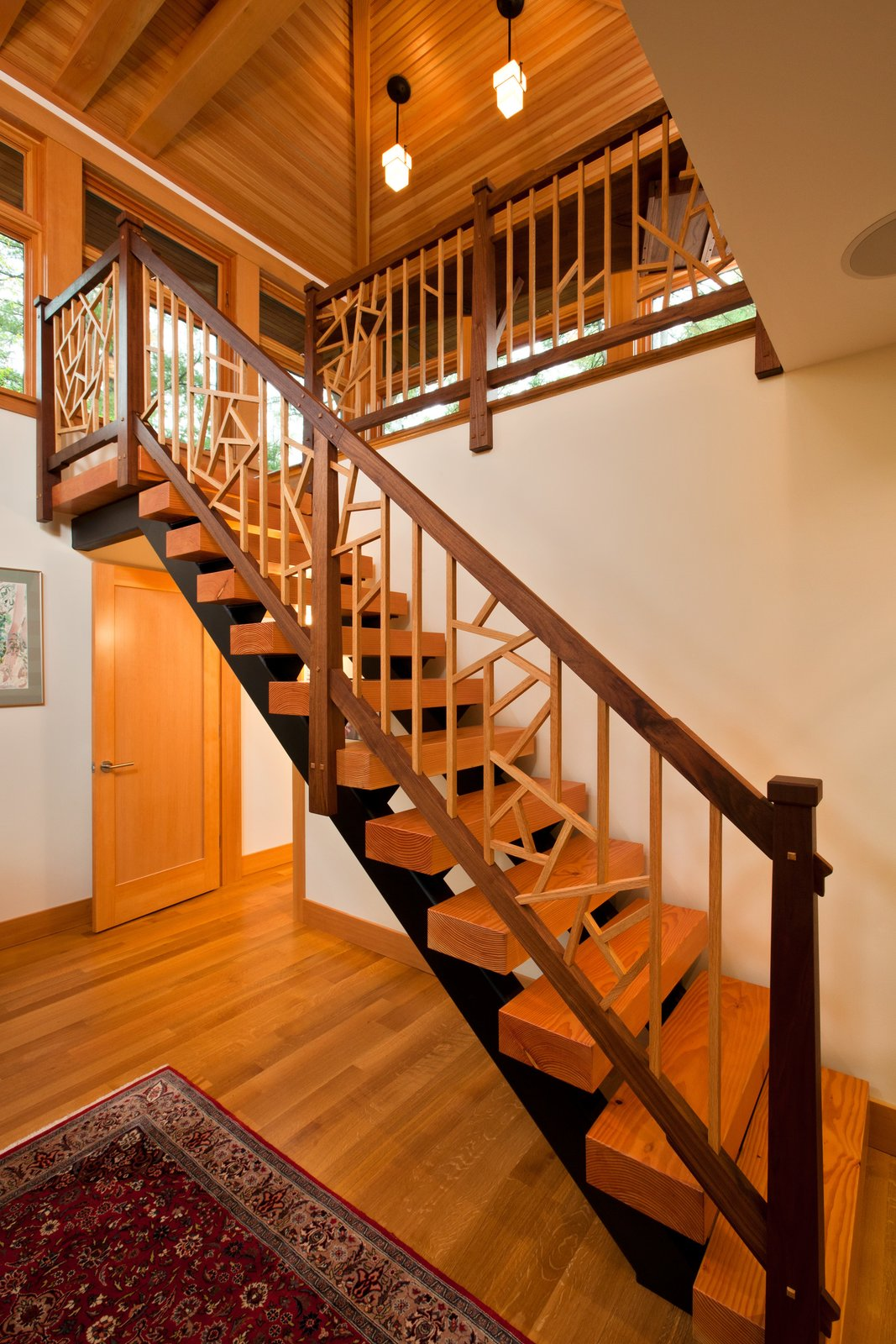 Staircase to second floor of home office, designed by local Adirondack artist