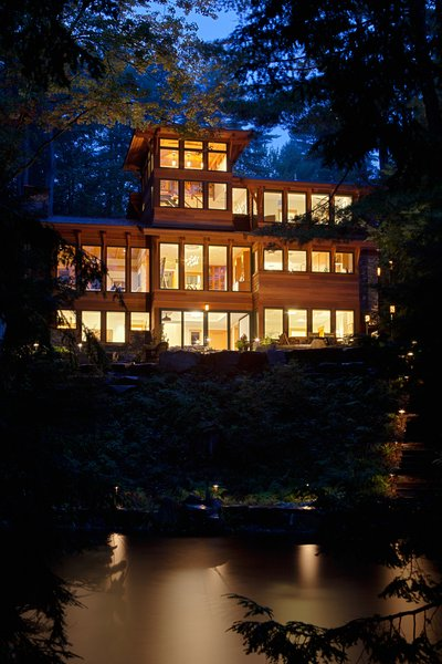 Nighttime view of house from Lake Luzerne Photo  of Fourth Lake Summer House modern home