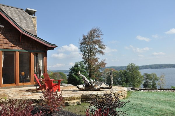 Locally sourced stone was used for the patio. Photo 6 of LEED Silver House modern home