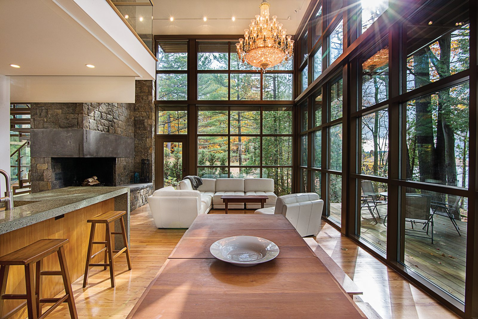 The design intent was to use natural materials with modern details, and to maximize the area of glass towards the lake.