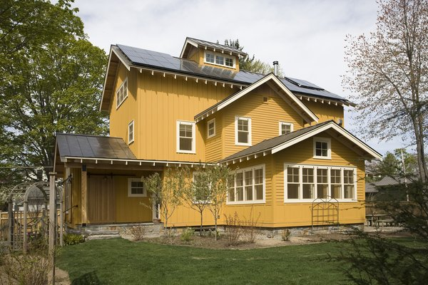 The roof is lined with both photovoltaic panels and solar hot water heaters on the large south facing slope. These panels provide about 8kw of electricity and meet all of the home's hot water needs. Photo 3 of Barn Reinvented - LEED Platinum Home modern home