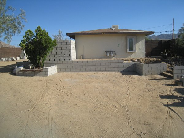 Modern home with outdoor, front yard, horizontal fence, concrete patio, porch, deck, and hardscapes. Building with block wall added.   Photo 5 of Modern Jewel in the Desert