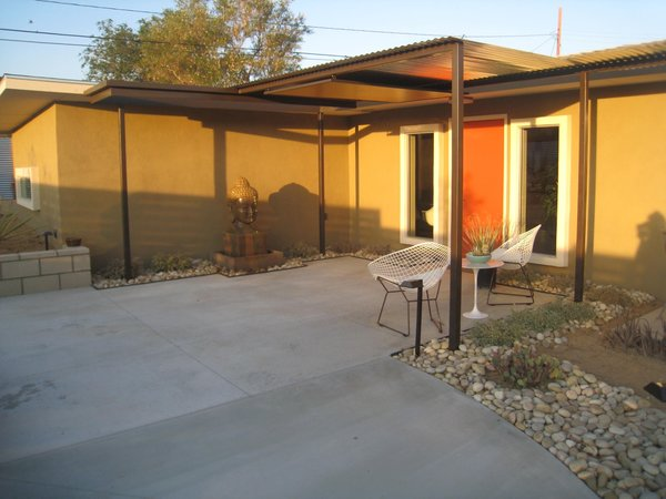 Modern home with outdoor, back yard, desert, walkways, shrubs, and stone patio, porch, deck. Decorative metal/wood structure defines the entry.  Photo 8 of Modern Jewel in the Desert