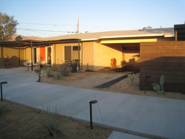 Modern home with outdoor, desert, concrete pool, side yard, and small pool. Carport was framed in to house the indoor pool.  Photo 10 of Modern Jewel in the Desert