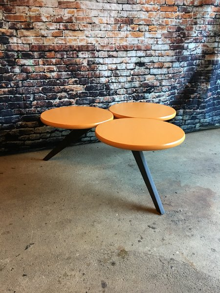 Modern home with living room and coffee tables. Orange painted  spruce tops Photo  of Tri-Circle Coffee tables