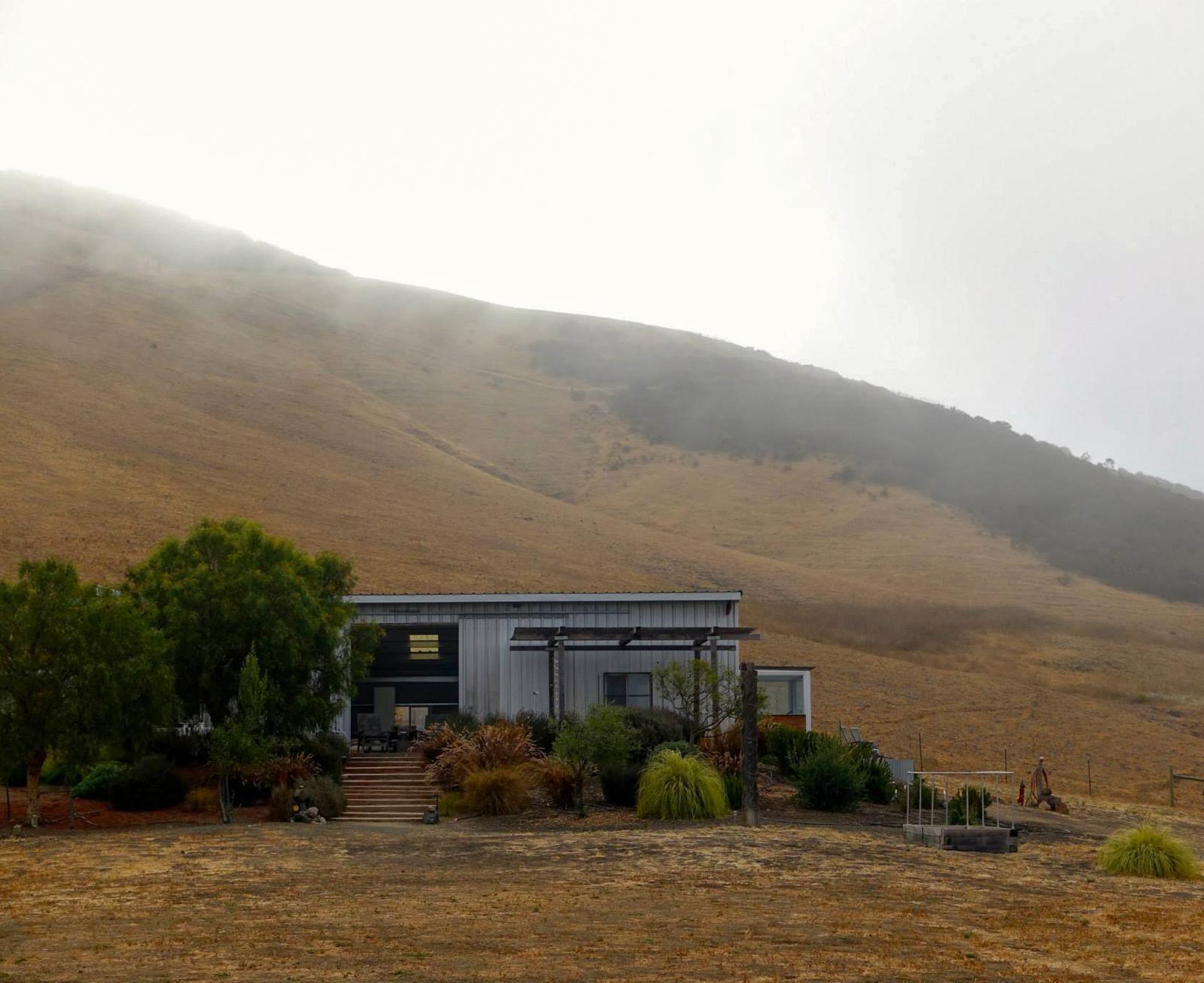 Barn in morning fog