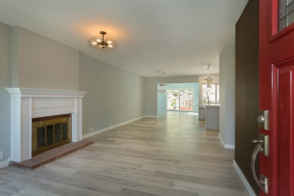 Modern home with living room, ceiling lighting, and gas burning fireplace. The foyer Photo 3 of Briarwood Place