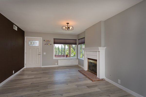 Modern home with living room, ceiling lighting, and gas burning fireplace. The living room Photo 4 of Briarwood Place