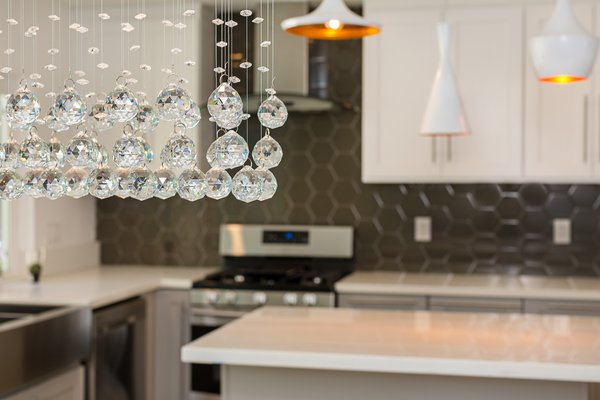 Modern home with dining room and ceiling lighting. Close up on the chandelier in the dining room Photo 7 of Briarwood Place