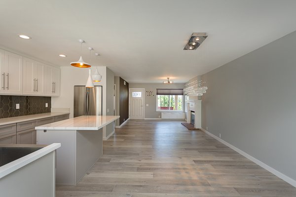 Modern home with dining room and ceiling lighting. Open concept view from the end of the kitchen through the doorway Photo 13 of Briarwood Place