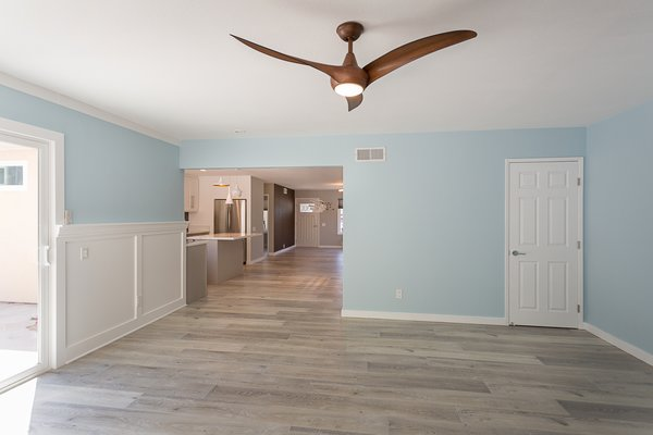Modern home with living room and ceiling lighting. The family room featuring a  Minka Aire ceiling fan Photo 17 of Briarwood Place