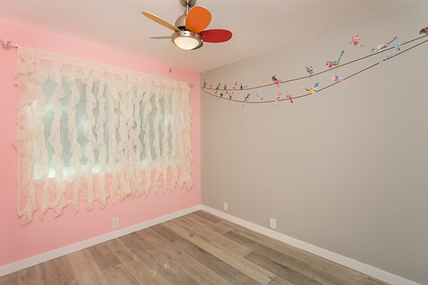 Modern home with ceiling lighting, kids room, bedroom, girl gender, and toddler age. Bedroom 2 Photo 20 of Briarwood Place