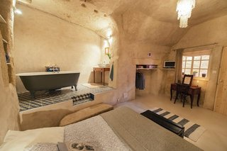 Ever Wanted to Stay in a Cave That's Actually Pretty Modern Inside? - Photo 4 of 10 - Located in converted caves in the Nazelles-Négron commune in France's Loire Valley, Amboise Troglodyte is a cozy, modern B&B that has a tiled nook bath area.