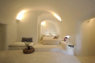Ever Wanted to Stay in a Cave That's Actually Pretty Modern Inside? - Photo 8 of 10 - Kapari Natural Resort in the 300-year-old village of Imerovigli on Santorini is pure bliss for those who like their interiors in white and earthy neutrals. The unique style of Cycladic architecture comes through beautifully in the organic lines of the smooth-edged walls, floors, and ceilings.
