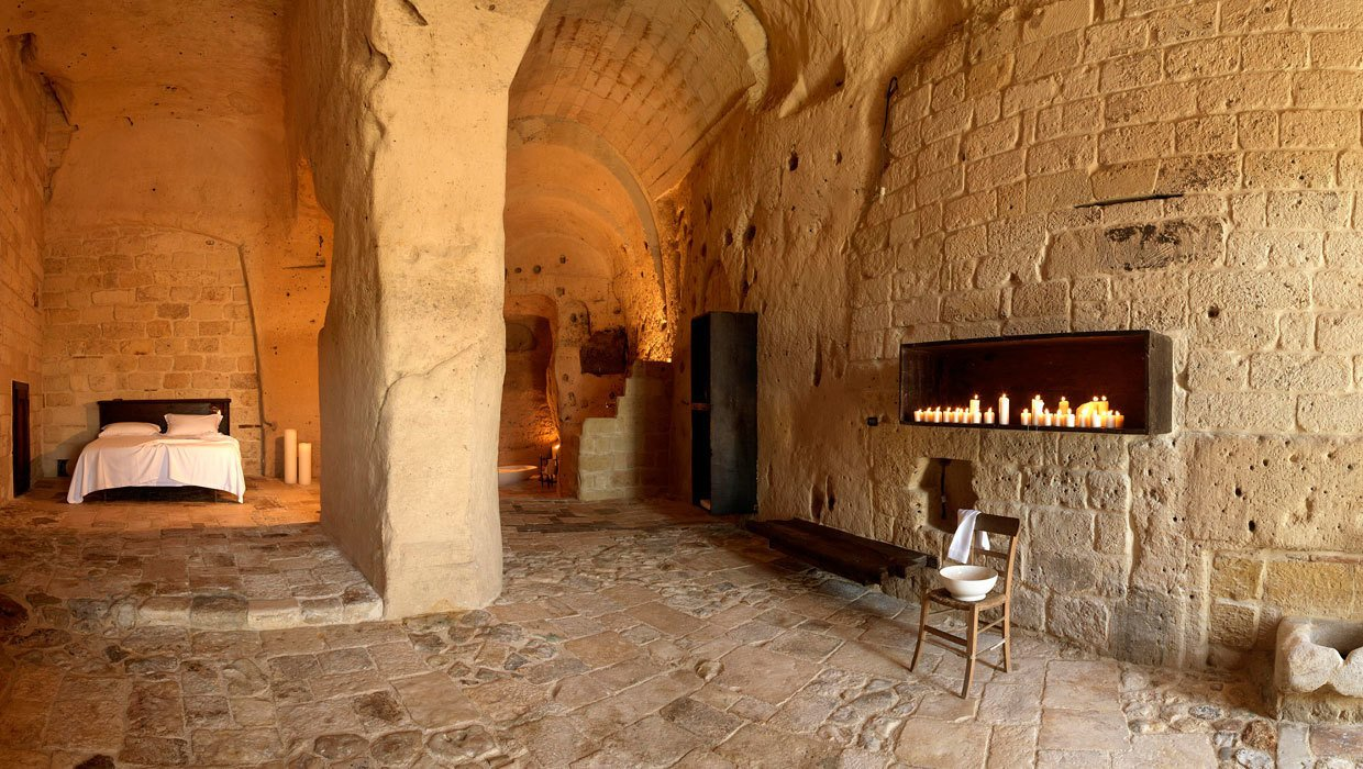 Located in the UNESCO World Heritage cave village of Sassi de Matera in Southern Italy, Sextantio Le Grotto Della Civita is furnished with rustic, Zen-like pieces to allow the interesting textures and medieval magic of its cave setting to shine through.