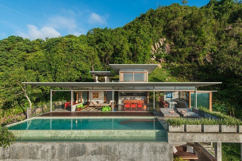 Built by architect and photographer Mark Gerritson, The Naked House is a stunning six-bedroom minimalist house on the Thai island on Koh Samui with concrete floors and plenty of outdoor space. Tagged: Outdoor, Raised Planters, Trees, Shrubs, Infinity Pools, Tubs, Shower, Large Pools, Tubs, Shower, Swimming Pools, Tubs, Shower, Back Yard, Metal Fences, Wall, and Planters Patio, Porch, Deck.  Photo 2 of 11 in Escape to the Jungle in One of These Modern Forested Retreats