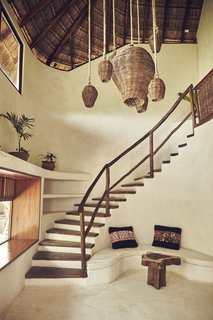 "Escape to the Jungle in One of These Modern Forested Retreats - Photo 4 of 10 - Cocooned by jungles along the Mexican Caribbean coast, Papaya Playa Project offers the best of both forest and sea. The design of this eco-friendly resort hotel uses ""Chukum,"" a traditional Mayan building technique that helps keep interiors cool."