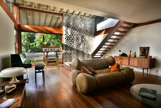 Escape to the Jungle in One of These Modern Forested Retreats - Photo 6 of 10 - Set in a 1970s Brutalism residence designed by Brazilian architect Wladimir Alves de Souzain, and located at the heart of Santa Teresa in Rio, Chez Georges, is a nine-bedroom hillside house with soaring ceilings and a music studio that overlooks the Brazilian rainforest.