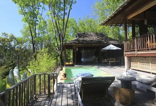 Escape to the Jungle in One of These Modern Forested Retreats - Photo 7 of 10 - Embraced by the jungles of Thailand's Koh Yao Noi Island, the villas at Six Senses Yao Noi have wooden poster beds, sofas upholstered in sunny yellow and orange, commodious bathrooms with a sunken bathtub, indoor and outdoor showers, a spacious infinity pool, and an outdoor pavilion.