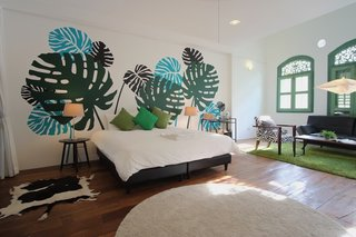 Experience a Modern, Eclectic Side of Singapore at One of These 10 City Stays - Photo 4 of 13 - The Fern Suite is a colorful, tropical space that fits three to six guests comfortably.