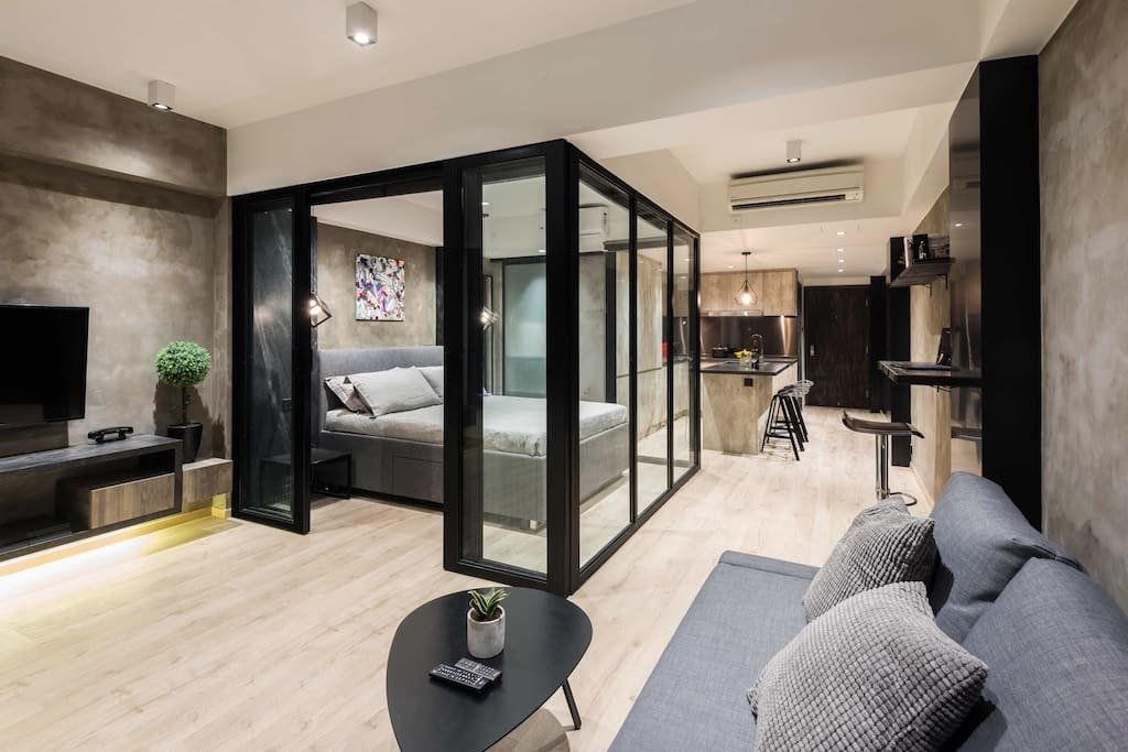 This, stylish apartment in Wan Chai was designed with a glass-framed bedroom cubicle in the middle of the space. The sleek, open-concept kitchen is equipped with an oven, fridge, built-in washing machine, Nepresso machine, toaster and powerful induction hobs.  Photo 7 of 11 in 10 Modern and Stylish Places to Stay in Hong Kong