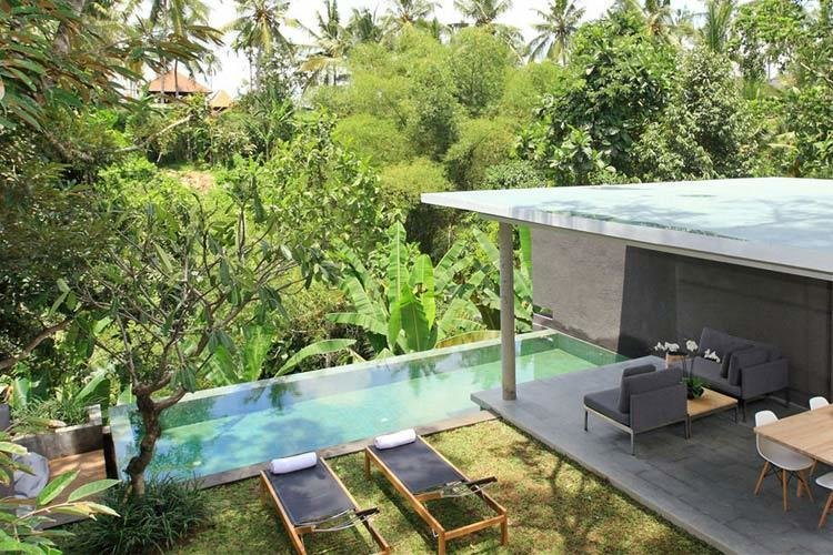 Located in the charming and artsy Ubud, and nestled within a verdant green valley, the eco-friendly Aria Villas designed by Singapore architect Chioh-Hui Goh offer a fresh, elegant take on Balinese style.  Photo 4 of 11 in Connect With Bali's Tropical Landscape at One of these Modern Villas