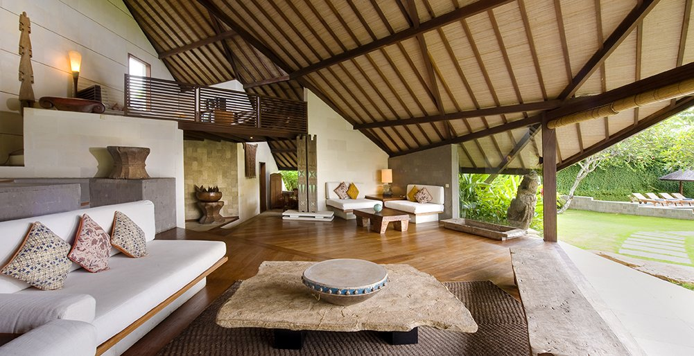 Built with natural local materials such as teakwood, rattan, and lava stone, one of the most interesting features in this property are the villas striking pitched shingled roofs.  Set within a 4,000 square meter garden estate in Umalas, Villa Bali Bali is a collection of two and three bedroom villas that can be rented separately or together to accommodate groups with as many as 15 people.  Photo 5 of 11 in Connect With Bali's Tropical Landscape at One of these Modern Villas