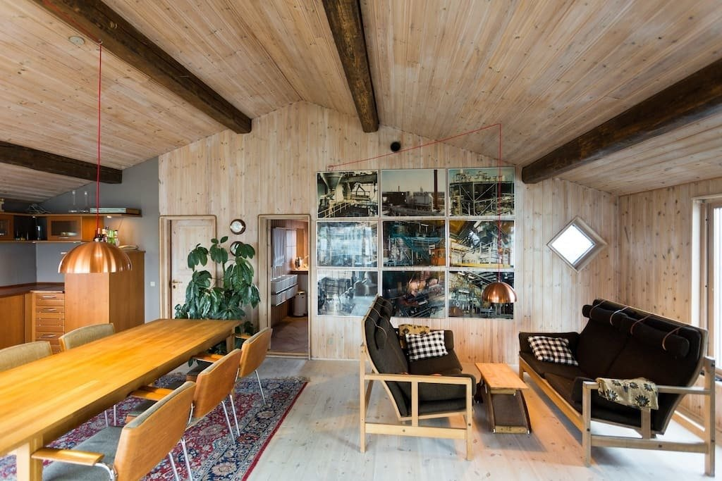 """""""If you are on the run, you can hide at our place. It is close to the sea and close to the sky, but it is far from everything else,"""" reports Claus, the owner for The Great Escape, a two-bedroom houseboat in Copenhagen with a hip, industrial feel."""