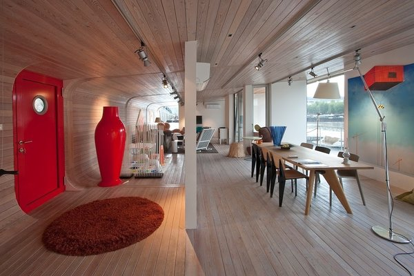 Make Yourself at Home in One of These Small Spaces on Boats That You Can Rent - Photo 4 of 10 - Moored in the stylish area of Holesovice in Prague, the sleek and contemporary Port X houseboat has floor-to-ceiling windows, outdoor terraces, a fully-equipped kitchenette, Italian sofa bed from Vlbieffe, and a Bang & Olufsen sound system.