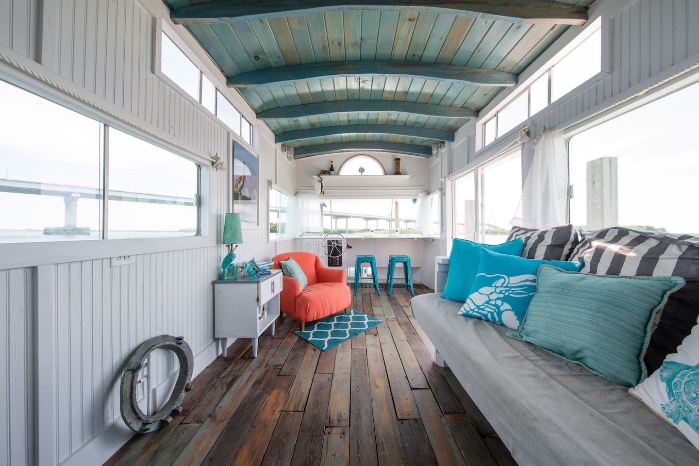 Located in a peaceful marine in downtown Charleston, Carolina, this compact and cozy houseboat was gutted and refurbished with reclaimed materials and comfortably sleeps three.