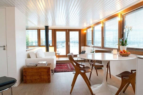 Make Yourself at Home in One of These Small Spaces on Boats That You Can Rent - Photo 8 of 10 - Moored on the Java Island just a short distance from Amsterdam's old city and Central Station, Somoya's Saloon is a studio abode on the upper deck of a classic steering ship with its own private bathroom, kitchenette, double bed, and lounge area.
