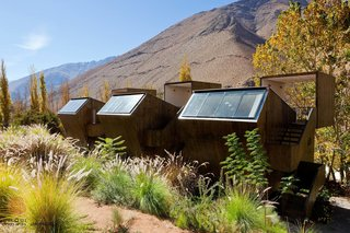 "Get Back to Basics by Staying at One of These Modern Cabins - Photo 5 of 10 - Elqui Domos, a hotel in Chile's Elqui Valley, offers ""observatory rooms""—triple-level wooden cabins on the upper slope of the land that offer direct views of the dramatic scenery."