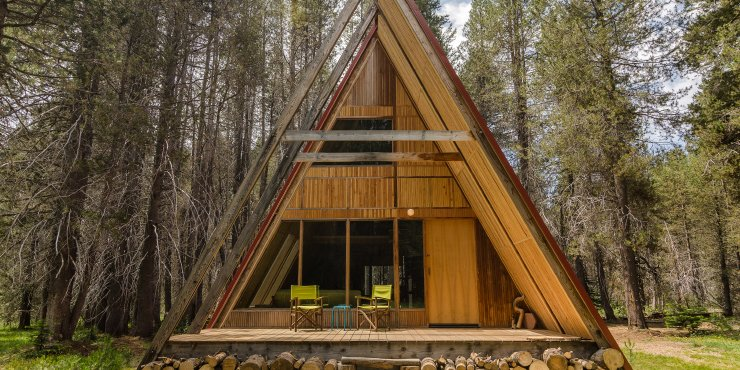 Sited on twenty acres of private land near Yosemite in the Sierra National Forest, these classic A Frame cabins are given a contemporary twist with full height glass windows, floating staircases and tatami rooms with futon beds.  Photo 6 of 10 in Get Back to Basics by Staying at One of These Modern Cabins