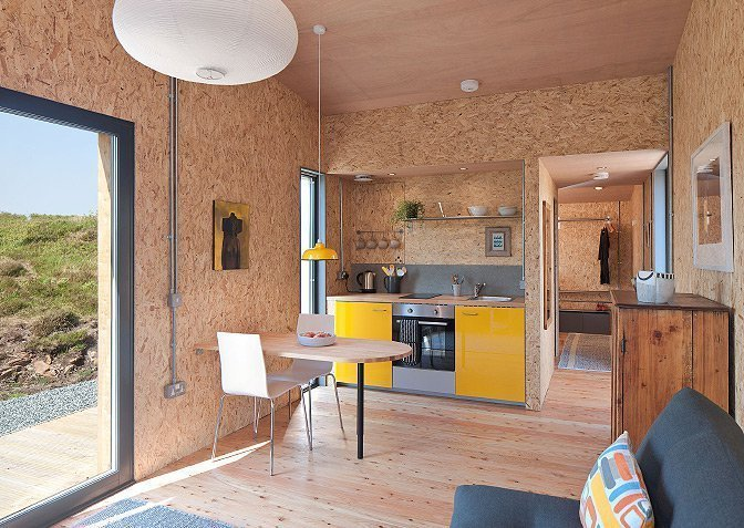 This compact, environmentally friendly modern studio cabin in the west coast of Scotland's Isle of Skye is designed by Rural Design Architects and perfect for a romantic escape in a remote site surrounded by natural beauty. Get Back to Basics by Staying at One of These Modern Cabins - Photo 8 of 10