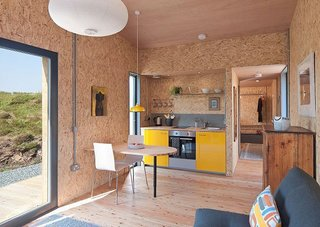 Get Back to Basics by Staying at One of These Modern Cabins - Photo 8 of 10 - This compact, environmentally-friendly studio on the west coast of Scotland's Isle of Skye was designed by Rural Design Architects and is perfect for escaping to a remote site.