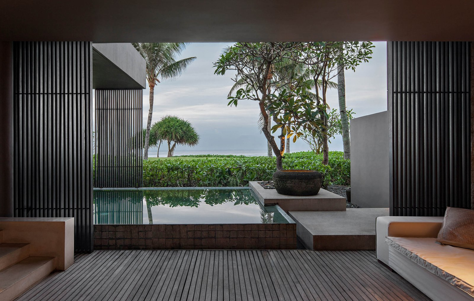 Tagged: Outdoor, Trees, Infinity Pools, Tubs, Shower, Swimming Pools, Tubs, Shower, Large Pools, Tubs, Shower, Shrubs, Wood Patio, Porch, Deck, and Back Yard.  Photo 6 of 9 in A Modern Bali Resort That's Inspired by the Local Landscape and Culture