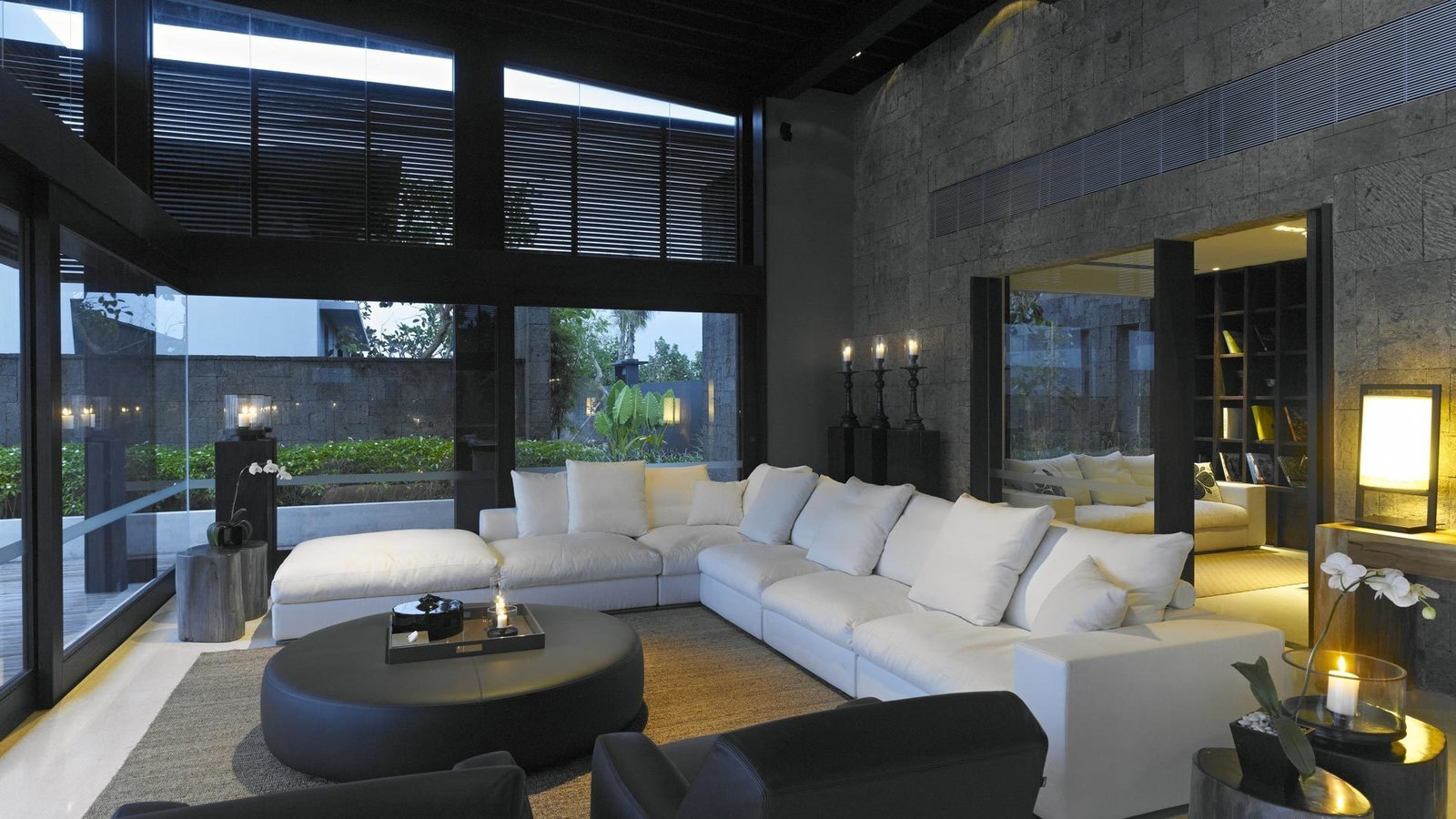 Tagged: Living Room, Sectional, Table Lighting, Chair, End Tables, Coffee Tables, and Rug Floor.  Photo 7 of 9 in A Modern Bali Resort That's Inspired by the Local Landscape and Culture