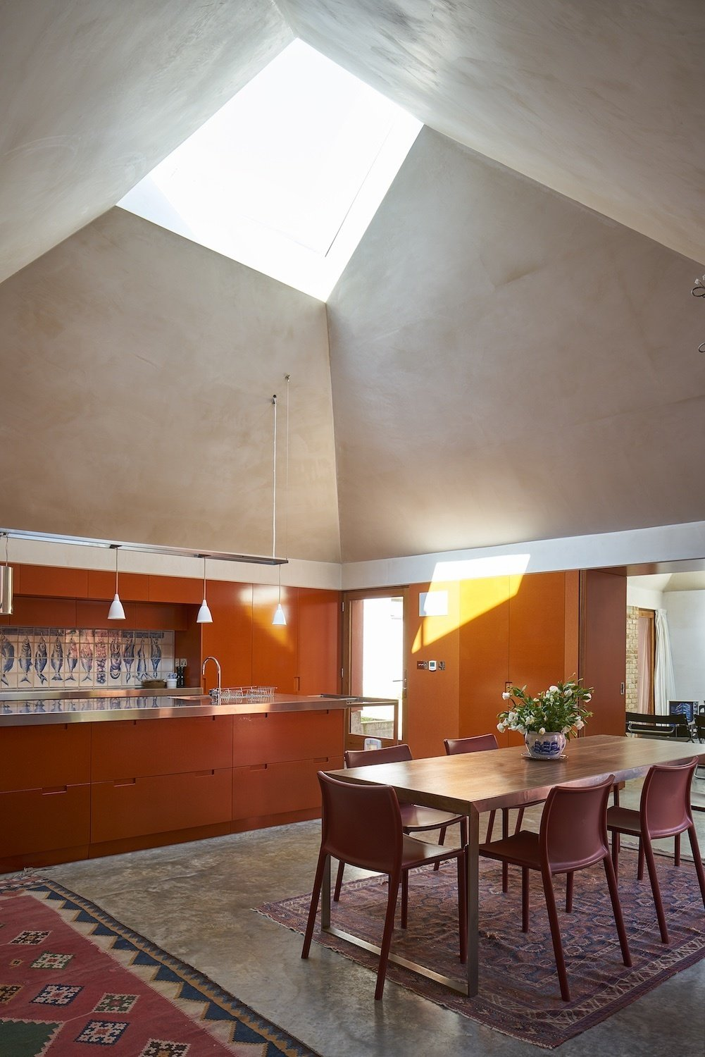 Tagged: Concrete Floor, Pendant Lighting, and Dining Room.  Photo 3 of 10 in Red Tin House That Makes the Most of Space and Light