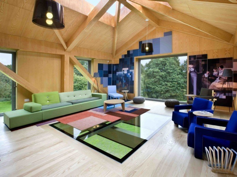Tagged: Living Room, Sofa, Ottomans, Coffee Tables, Chair, Pendant Lighting, and Light Hardwood Floor.  Photo 4 of 11 in Take a Modern British Holiday in a Gleaming Cantilevered Barn