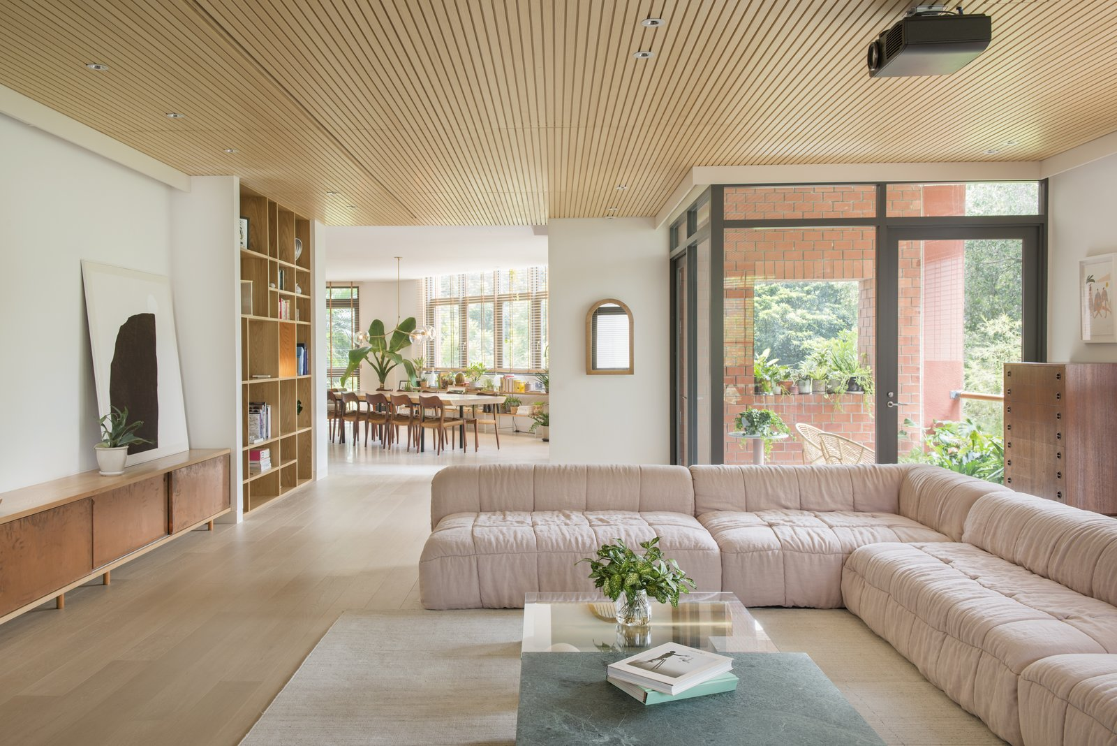 Tagged: Living Room, Coffee Tables, Ceiling Lighting, Sectional, Recessed Lighting, and Light Hardwood Floor.  Photo 2 of 10 in The Light and Airy Apartment G in Downtown Singapore
