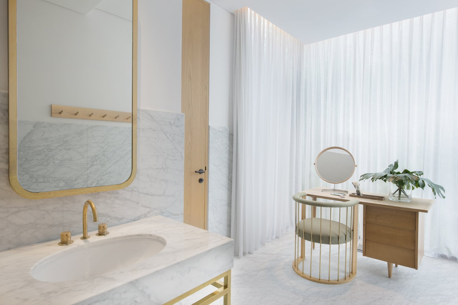 Tagged: Bath Room, Undermount Sink, Marble Wall, Marble Counter, and Marble Floor.  Photo 6 of 10 in The Light and Airy Apartment G in Downtown Singapore
