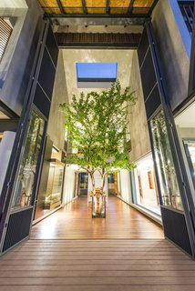 Cool, Asian Courtyard Home With A Brutalist Core - Photo 2 of 10 -