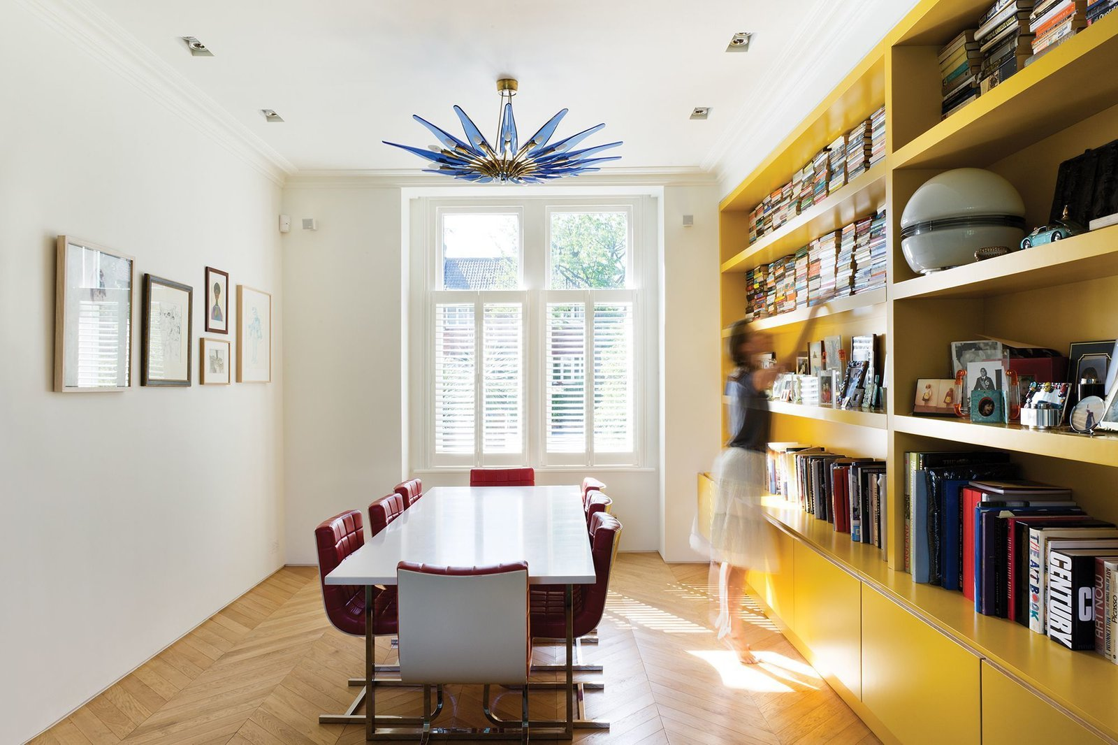 Tagged: Storage, Sofa, Dining Room, Shelves, and Light Hardwood Floor.  Photo 4 of 13 in Bright Bauhaus Colors Fill This Brick Edwardian House in London